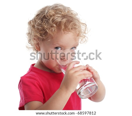 Little girl with a water glass - stock photo