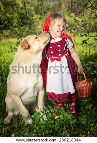 """Little girl with a wolf . The fairy tale """" Red Riding Hood"""" - stock photo"""