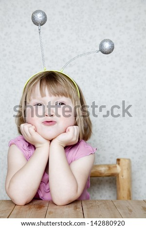 Little girl with Alien Antennas - stock photo