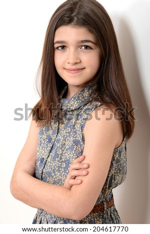 little girl with arms crossed