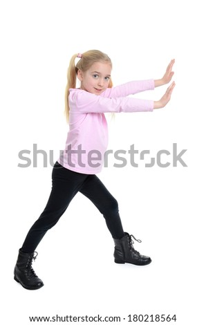 little girl with arms extended in front pushing motion - stock photo