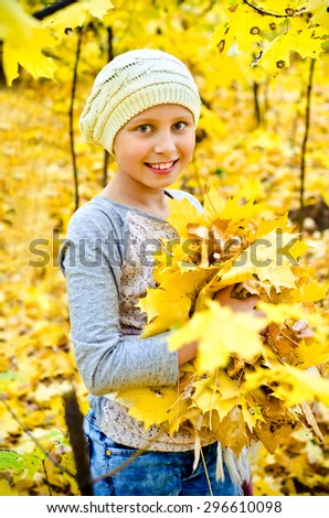 little girl with autumn leaves - stock photo