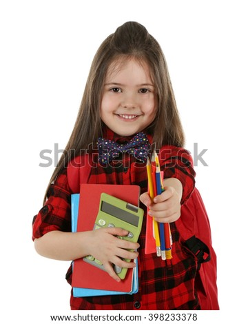Little girl with backpack holding school stationery isolated on white - stock photo