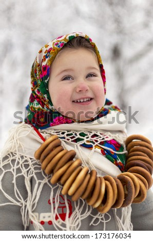 little girl with bagels winter - stock photo