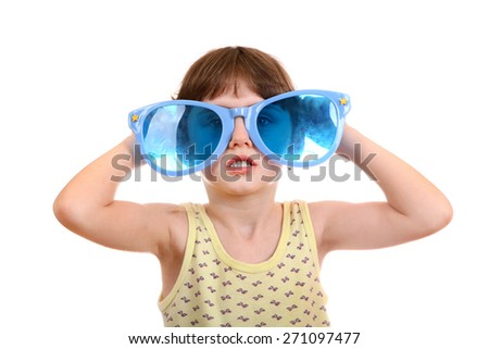 Little Girl with Big Blue Glasses Isolated on the White Background