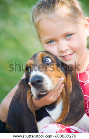 little girl with big  dog playing at summertime