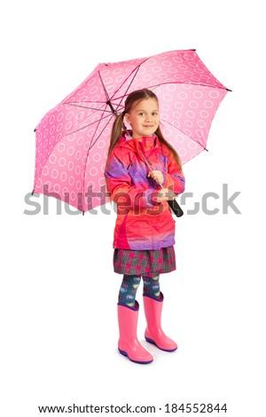 Little girl with big pink umbrella - stock photo