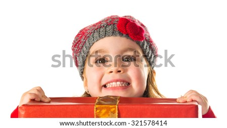 Little girl with big present - stock photo