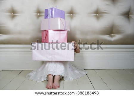 Little girl with birthday presents - stock photo