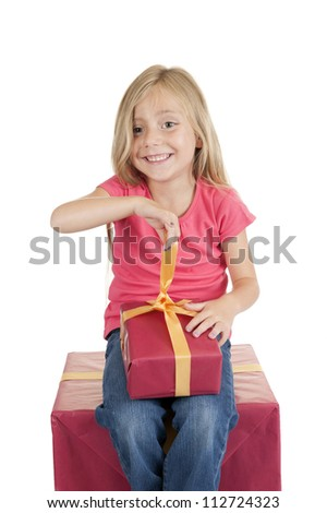 little girl with birthday presents, isolated on white background