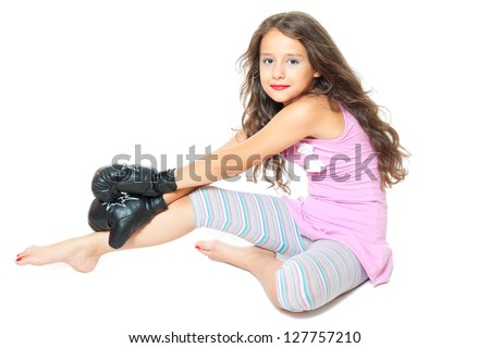 little girl with black boxing gloves isolated on white - stock photo
