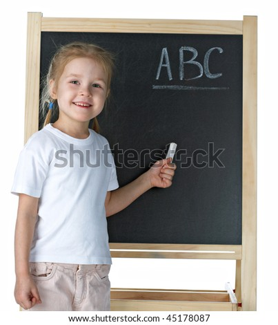 Little girl with blackboard on white background - stock photo