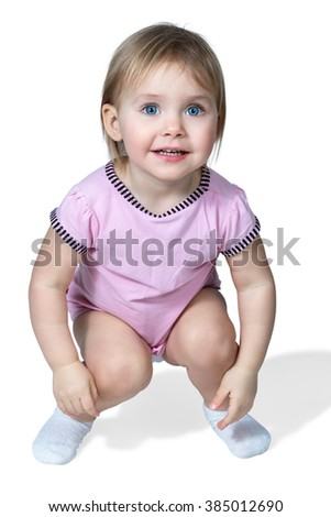 Little girl with blue eyes crouched down isolated on white background - stock photo