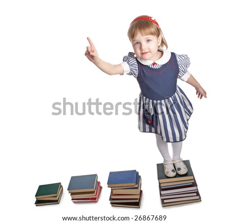 little girl with book on white background - stock photo