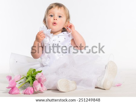 Little girl with bouquet of tulip flowers in hands