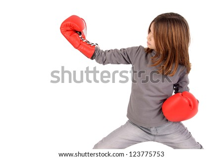 little girl with boxing gloves