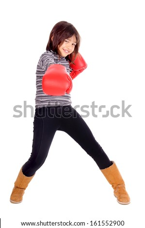 little girl with boxing gloves isolated in white - stock photo