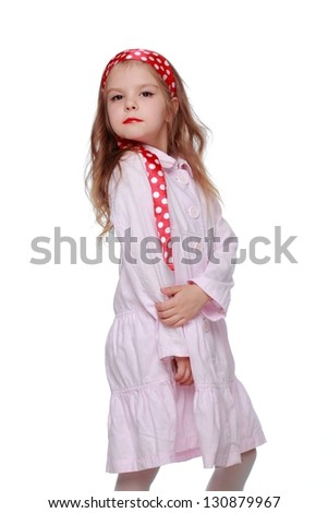 Little girl with bright red lips in white dress on Beauty and Fashion