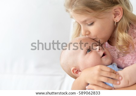 Little girl with brother