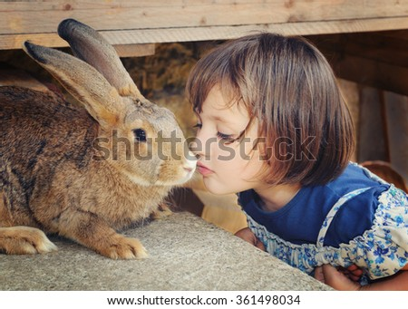 little girl with brown rabbit - stock photo