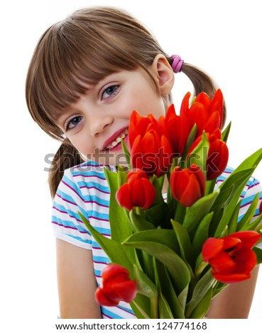 little girl with bunch of tulips - stock photo