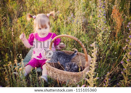 little girl with cats in basket outdoor - stock photo