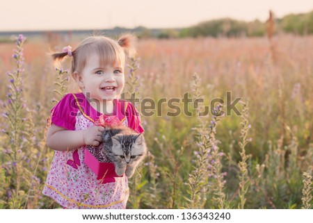 little girl with cats  outdoor - stock photo