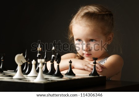 little girl with chess