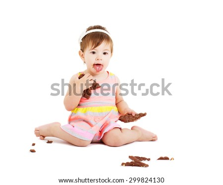 little girl with chocolate isolated on white - stock photo