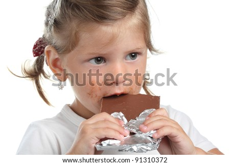 little girl with chocolate on a white background - stock photo