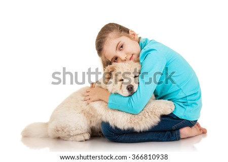 Little girl with chow-chow puppie isolated on white background - stock photo
