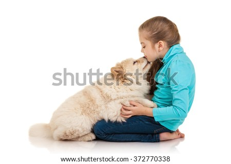 Little girl with chow-chow puppie isolated on white background