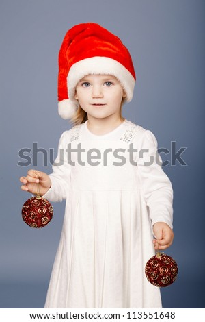 little girl with christmas balls - stock photo