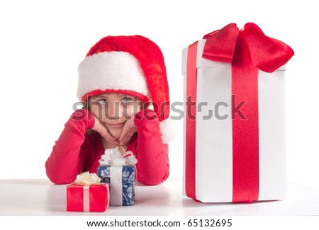 Little girl with Christmas presents