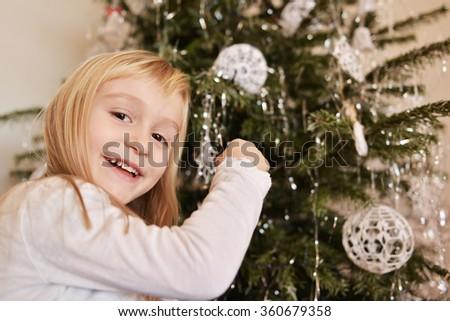 little girl with christmas tree - stock photo