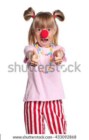 Little girl with clown nose showing thumbs up gesture, isolated on white background - stock photo