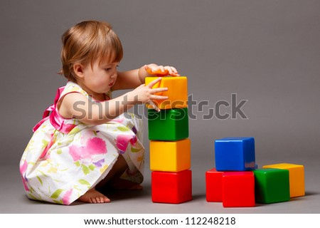 little girl with cubes - stock photo