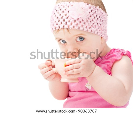 little girl with cup isolated on white - stock photo