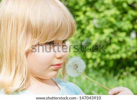 little girl with dandelion - stock photo