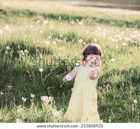 little girl with dandelions - stock photo