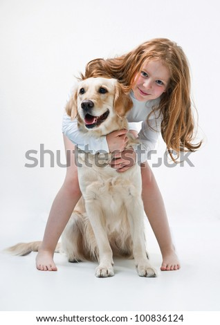 Little girl with dog on the white background - stock photo