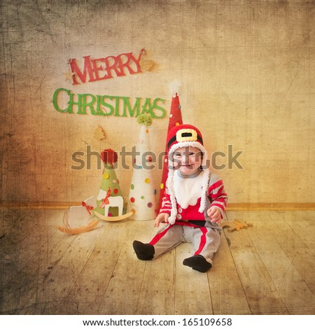 Little girl with Down syndrome laughs heartily in Santa Claus costumes - stock photo