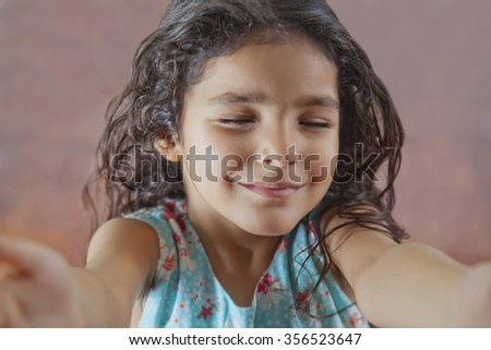 Little girl with eyes closed