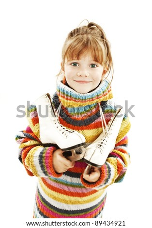 Little girl with figure skates. Studio shoot - stock photo
