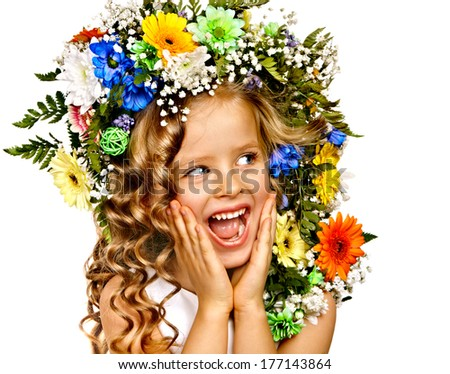 Little girl with flower hairstyle. Isolated. - stock photo