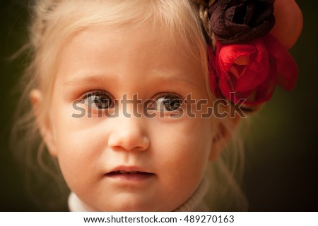 Little girl with flowers in her hair. Retro style