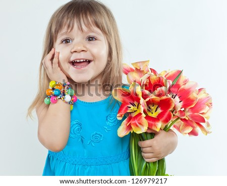 Little girl with flowers in their hands
