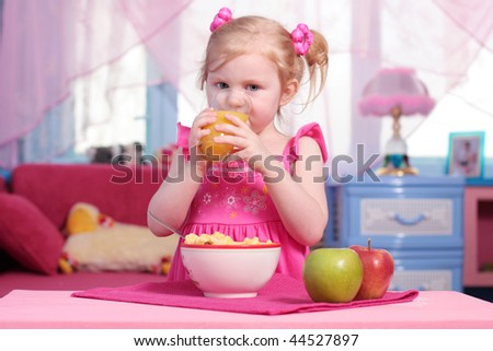 little girl with food - stock photo