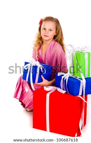 Little girl with gift boxes isolated on white