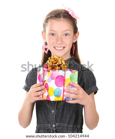Little girl with gift isolated on white - stock photo